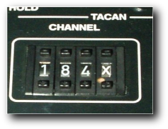The auxcomm channel selector knob
